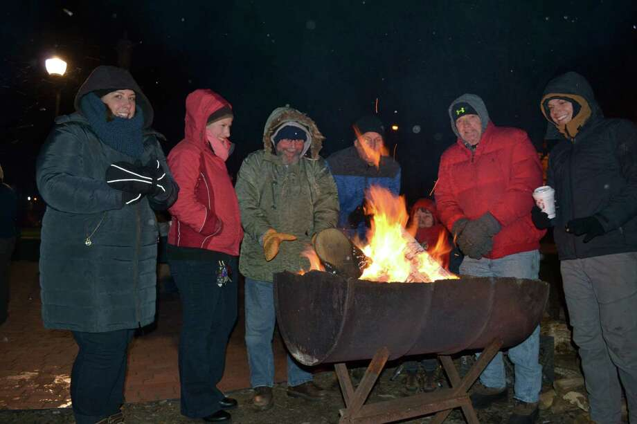 The YMCA's annual Freezin' for a Reason fundraiser and awareness event will be held Friday, Dec. 13 at East End Park in Winsted. Above, participants at a previous event warm up. Photo: Contributed Photo /Not For Resale /
