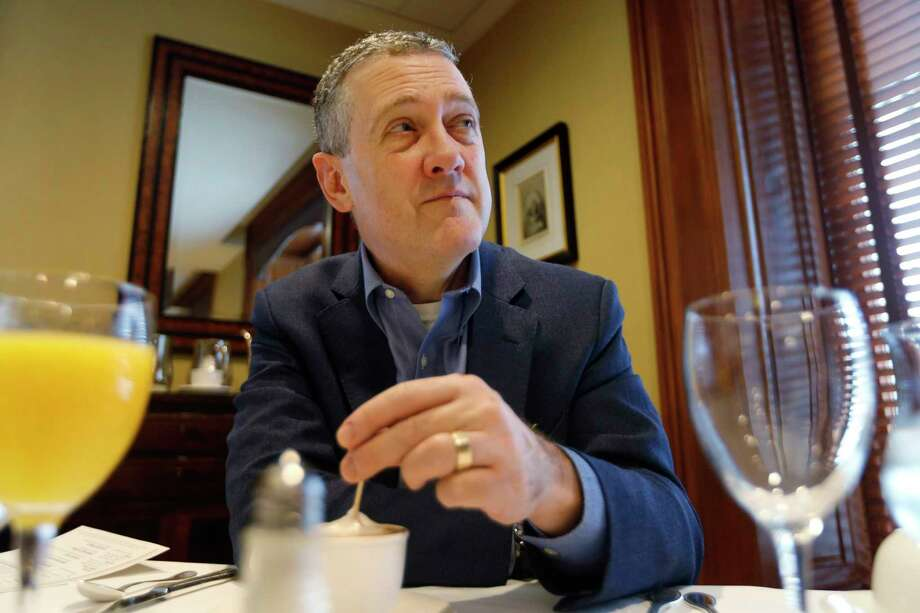In this Nov. 19, 2019, photo James Bullard, president of the St. Louis Federal Reserve Bank, listens during an interview in Richmond, Va. (AP Photo/Steve Helber) Photo: Steve Helber / Copyright 2019 The Associated Press. All rights reserved