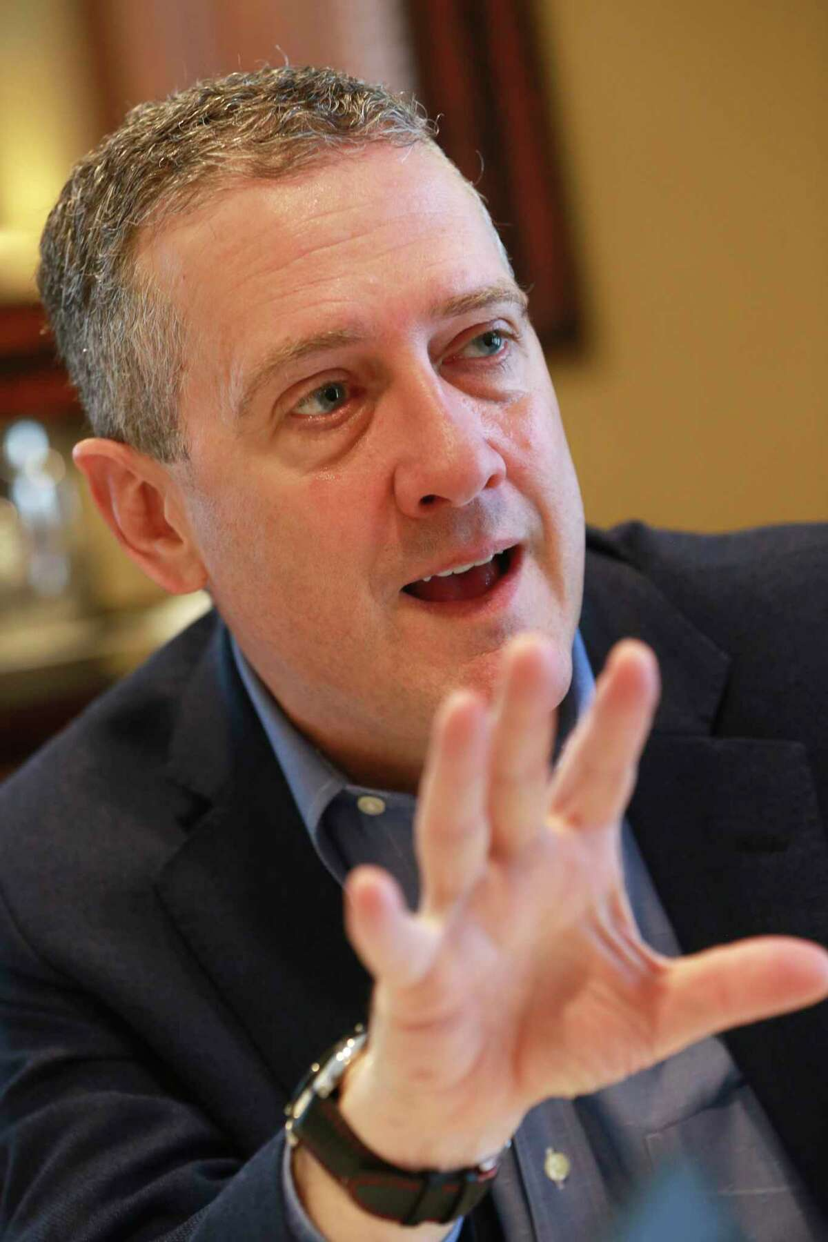 In this Nov. 19, 2019, photo James Bullard, president of the St. Louis Federal Reserve Bank, gestures during an interview in Richmond, Va. (AP Photo/Steve Helber)