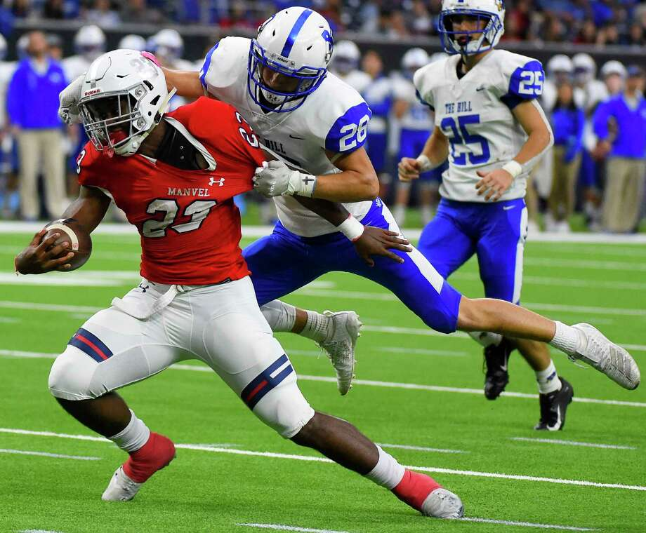 Manvel running back Donovan Eaglin, left, breaks the tackle of Barbers Hill defensive back Josh Bishop during the second half of a 5A Division II regional high school football playoff game, Friday, Nov. 29, 2019, in Houston. Photo: Eric Christian Smith, Contributor / Houston Chronicle