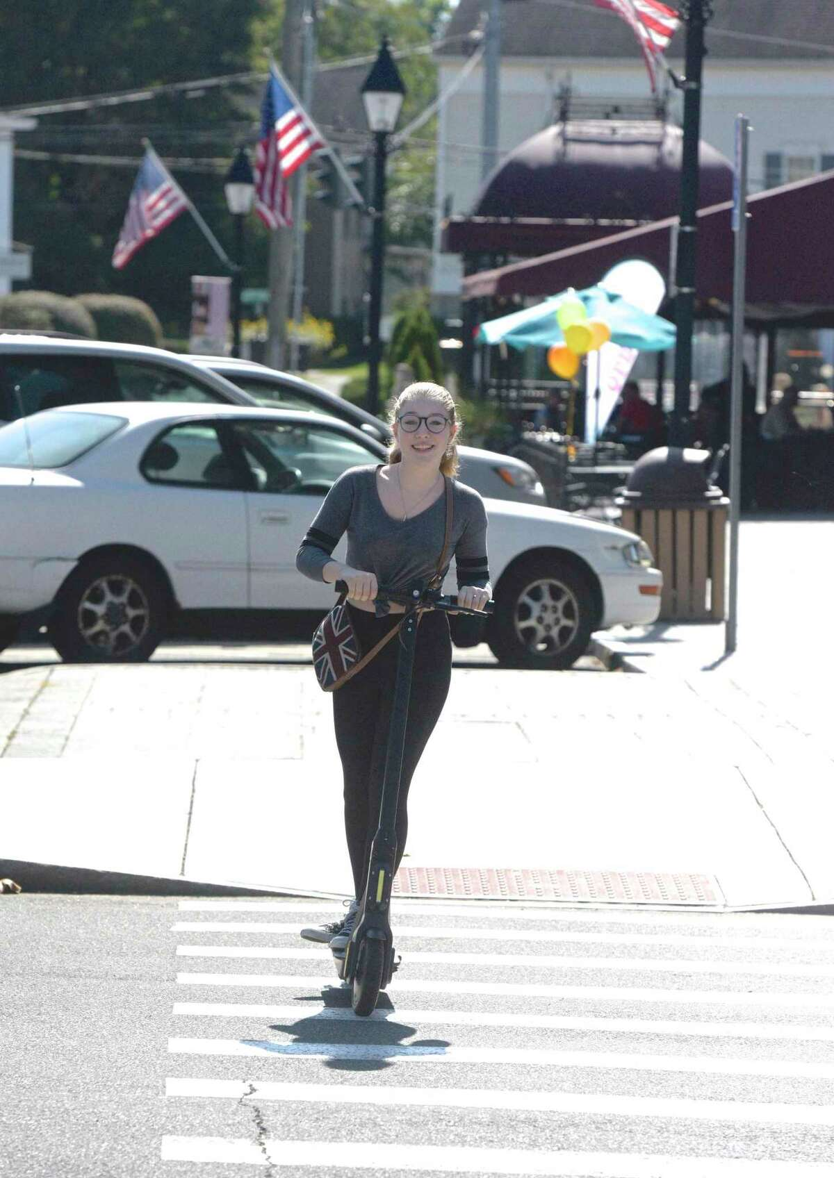 In September, Riley Mahan of New Milford was seen riding a scooter available for rent on the corner of Main & Bank Street in town.