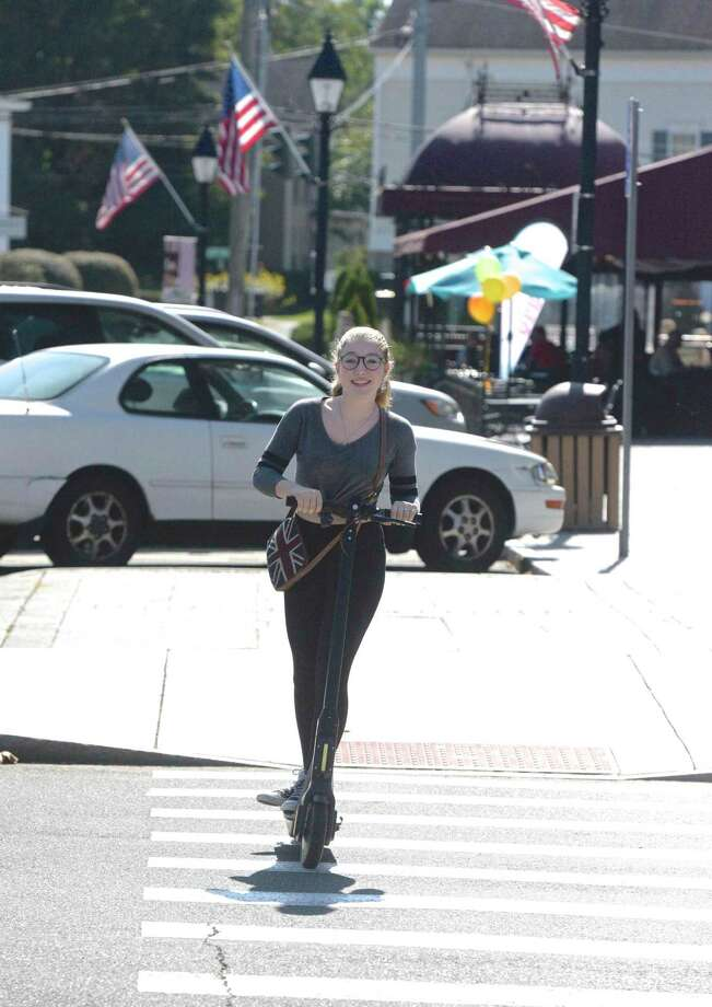 In September, Riley Mahan of New Milford was seen riding a scooter available for rent on the corner of Main & Bank Street in town. Photo: H John Voorhees III / Hearst Connecticut Media / The News-Times