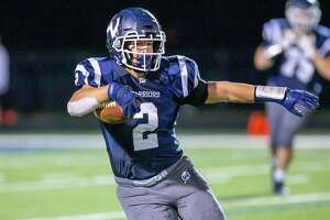 Drew Phillips and the Wilton football team are headed to the state playoffs for the first time since 1995. Phillips scored three touchdowns as the Warriors routed Trinity/Wright Tech, 63-20, on Thursday, Nov. 27, 2019.