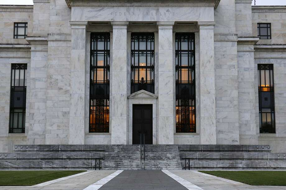 File-This July 31, 2019 file photo shows the Federal Reserve Building in Washington. The Federal Reserve says corporate debt remains at historically high levels but overall the U.S. financial system is resilient, a view in sharp contrast to the problems that led to the 2008 financial crisis. (AP Photo/Patrick Semansky, File) Photo: Patrick Semansky, Associated Press