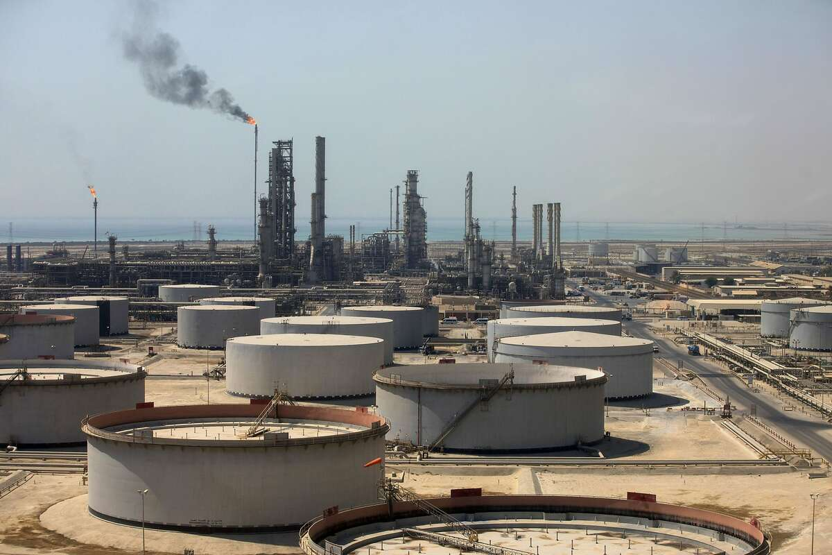 Crude oil storage tanks stand at the oil refinery operated by Saudi Aramco in Ras Tanura, Saudi Arabia, on Oct. 1, 2018. MUST CREDIT: Bloomberg photo by Simon Dawson.
