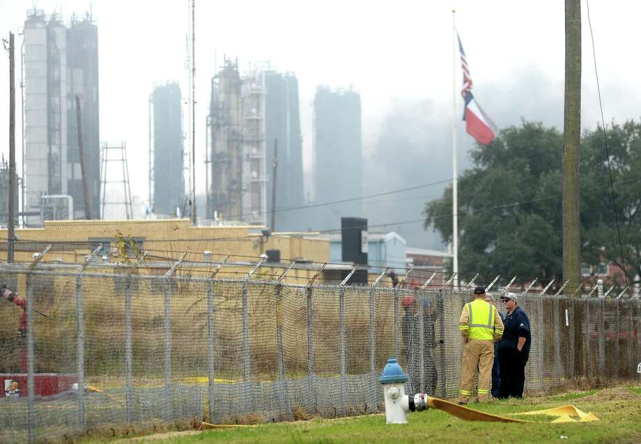 Crews gather at the fenceline of the nearby Lions plant in Port Neches as first responders continue to battle the fire at the TPC chemical plant Friday. Photo taken Friday, November 29, 2019 Kim Brent/The Enterprise Photo: Kim Brent / The Enterprise / BEN