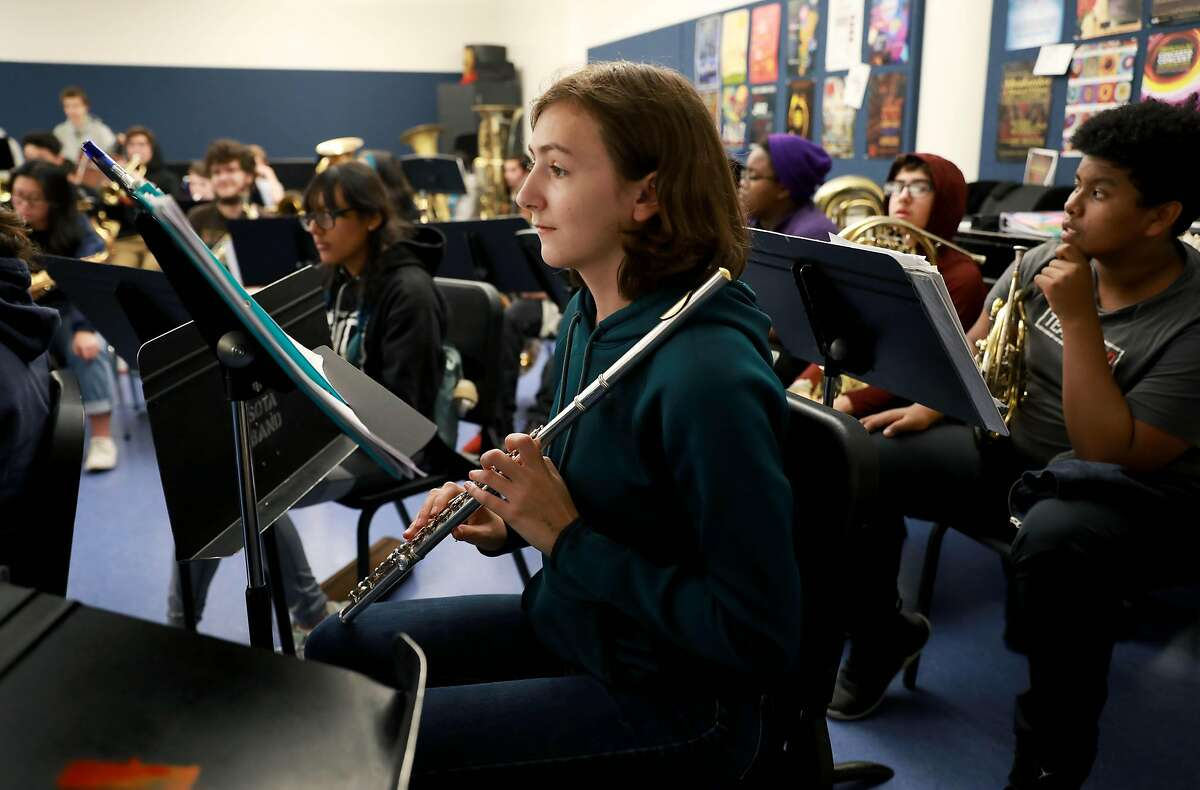 """Senior Madeline Bedwell, 17, plays her flute as she performs a song during band class at Ruth Asawa High School of the Arts in San Francisco, Calif., on Friday, November 22, 2019. Bedwell, who has been playing the instrument for nine years, has applied to college at UC Berkeley, UC Santa Cruz, UC Santa Barbara, UC San Diego, UC Los Angeles, and UC Davis. """"The UC's have a cool aerospace program that I would like to get into but it is capped in most schools, so if I don't get into them, (I'll) probably gonna go into either engineering undeclared or some physical science major undeclared,"""" Bedwell said."""