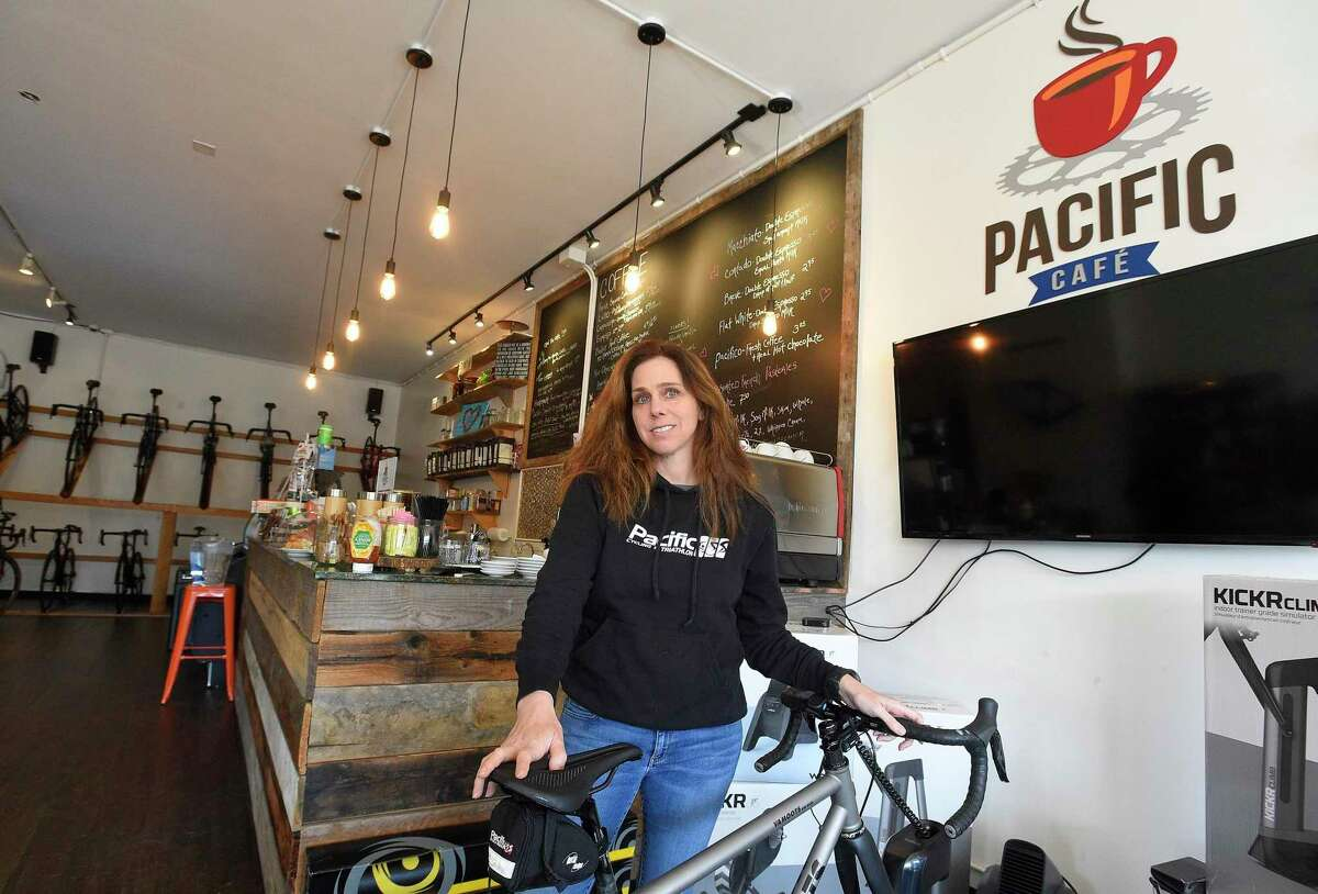 Julie Gabay, owner of Pacific Cycling and Triathlon, stands in the cafe of her store at 984 High Ridge Road in Stamford, Conn., on Nov. 29, 2019. Despite no longer having an online store, the business has already beaten its 2018 sales, according to Gabay.