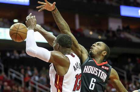 Houston Rockets forward Gary Clark (6) tries to block a pass by Miami Heat center Bam Adebayo (13) during the third quarter of an NBA basketball game at the Toyota Center on Wednesday, Nov. 27, 2019, in Houston.
