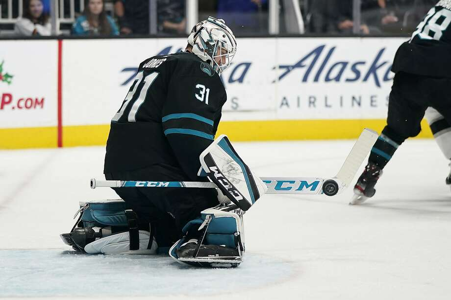Sharks goaltender Martin Jones turns aside a shot in the second period. He stopped 33 shots and was 1:49 from his 23rd shutout when the Kings scored. Photo: Tony Avelar / Associated Press