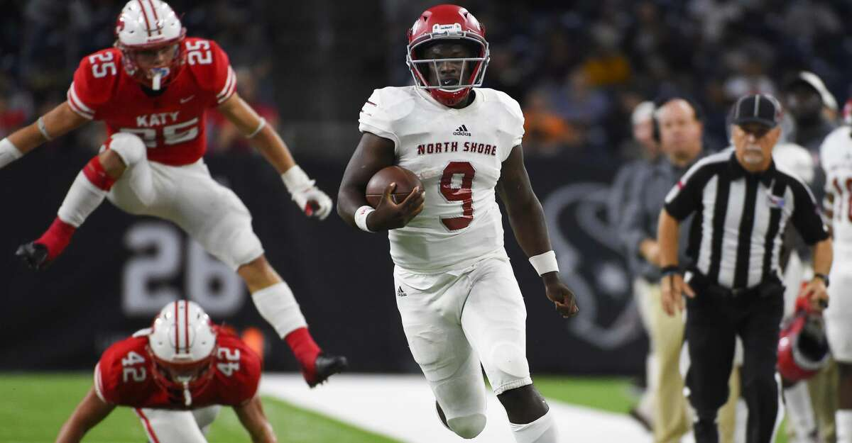 North Shore quarterback Dematrius Davis (9) runs past Katy linebackers Ty Kana (42) and Shepherd Bowling for a touchdown during the first half of a 6A Division 1 regional high school football playoff game, Friday, Nov. 29, 2019, in Houston.
