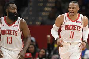 Houston Rockets guard Russell Westbrook (0) reacts next to guard James Harden (13) during the second half of an NBA basketball game against the Washington Wizards, Wednesday, Oct. 30, 2019, in Washington. The Rockets won 159-158. (AP Photo/Nick Wass)