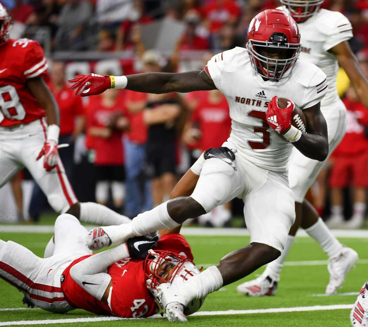 PHOTOS: High school football playoffs - regional semifinals North Shore running back Zach Evans (3) breaks the tackle of Katy defensive back Dalton Johnson and scores a touchdown during the first half of a 6A Division 1 regional high school football playoff game, Friday, Nov. 29, 2019, in Houston. >>>See more photos from last week's playoff matchups ...