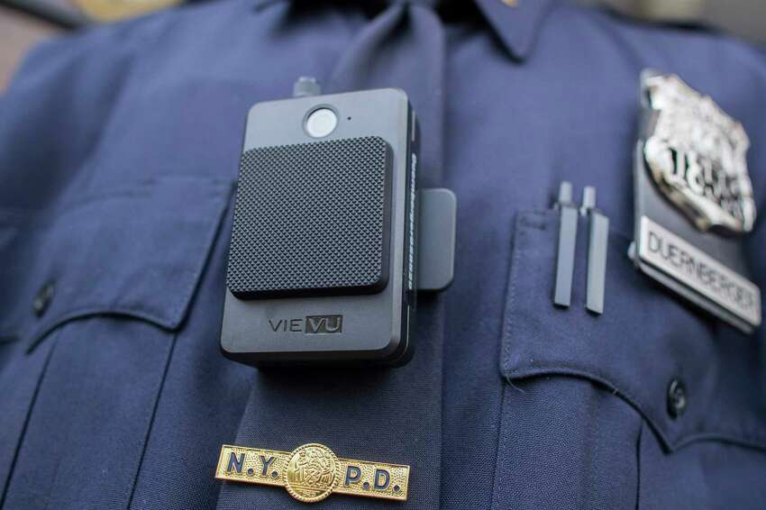 FILE - In this April 27, 2017 file photo, a police officer wears a newly-issued body camera in New York. Some lawmakers are proposing to equip state troopers with body cameras in New York, one of few states where the primary law enforcement agency doesna€™t have body or dashboard cameras already. The New York state police force is the largest among them. (AP Photo/Mary Altaffer, File)