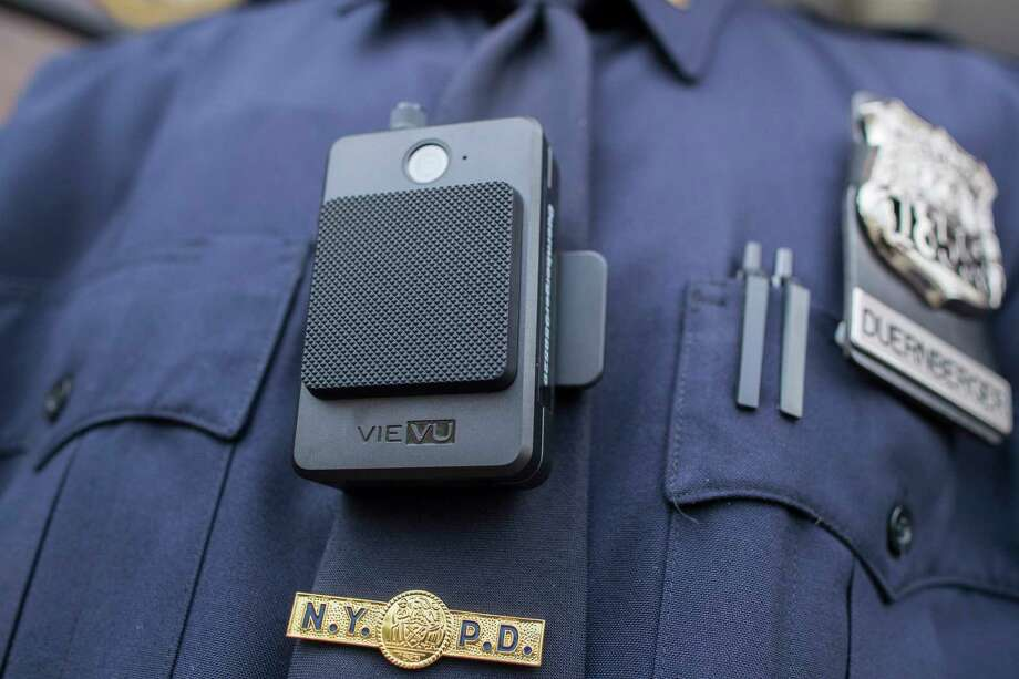 FILE - In this April 27, 2017 file photo, a police officer wears a newly-issued body camera in New York.  Some lawmakers are proposing to equip state troopers with body cameras in New York, one of few states where the primary law enforcement agency doesna€™t have body or dashboard cameras already.  The New York state police force is the largest among them.   (AP Photo/Mary Altaffer, File) Photo: Mary Altaffer / Copyright 2017 The Associated Press. All rights reserved.