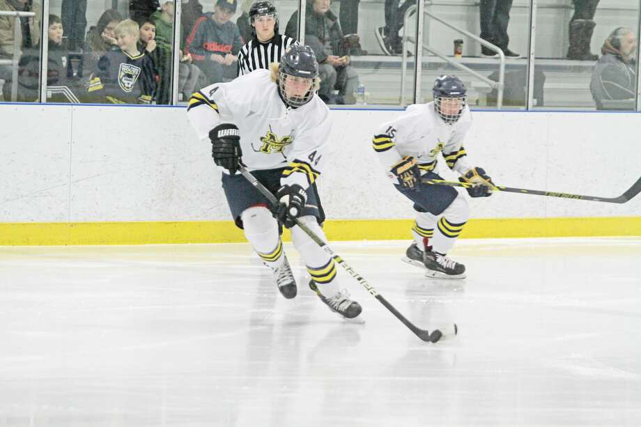 Manistee's Saku Ruotsalainen moves the puck during the co-op Chippewas' home opener at West Shore Community Ice Arena on Friday night. Photo: Kyle Kotecki/News Advocate