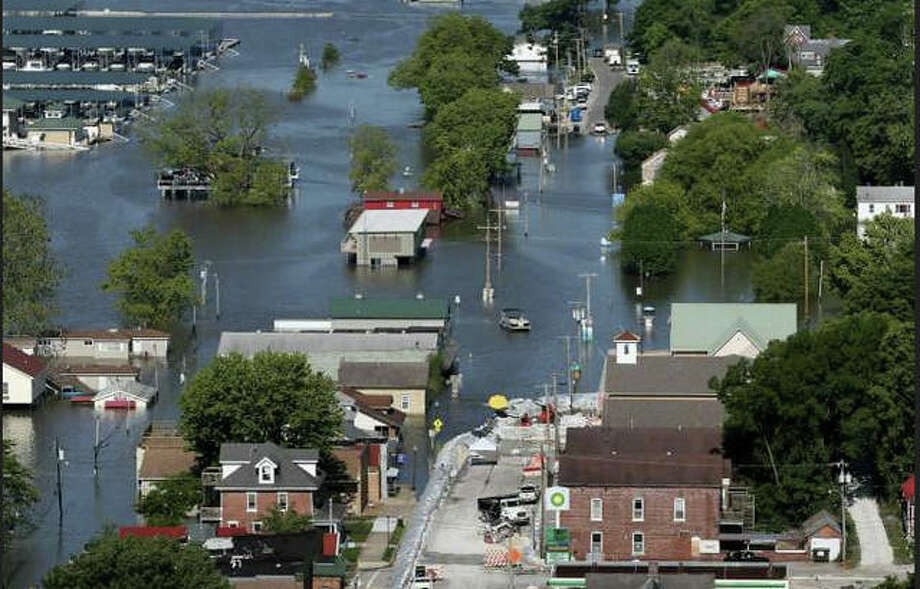 In this June 5, 2019 file photo, Main Street in downtown Grafton, Ill., is swamped with Mississippi River flood water during historic flooding in Grafton. After a year that has seen some of the worst flooding ever in parts of the Midwest, concern is already rising that the spring of 2020 may bring more high water to places that still haven't fully recovered. . (David Carson/St. Louis Post-Dispatch via AP, File)