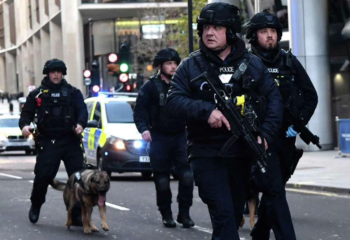 TOPSHOT - Armed police with dogs patrol along Cannon Street in central London, on November 29, 2019 after reports of shots being fired on London Bridge. - The Metropolitan Police on Friday said several people were injured and a man was held after a stabbing near London Bridge in the centre of the British capital. (Photo by Ben STANSALL / AFP) (Photo by BEN STANSALL/AFP via Getty Images)