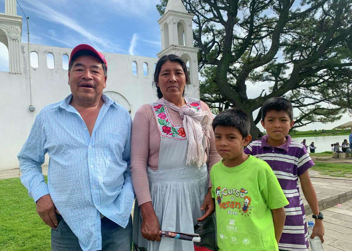 Angel Perez Roldán, 62, and his wife Dominga Mariel, 55, say their lives have improved under Mexico's President Lopez Obrador.