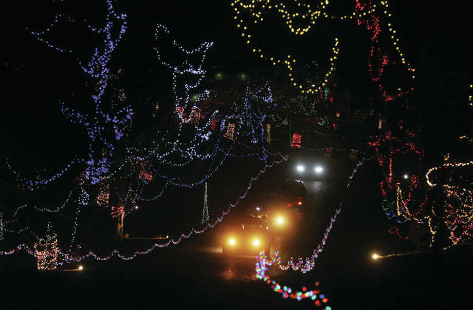 A line of cars nears the end of Alton's Christmas Wonderland, a holiday light display at Rock Spring Park. The display opened Friday. Despite cold, wet weather, more than 200 cars had gone through in the first 45 minutes.