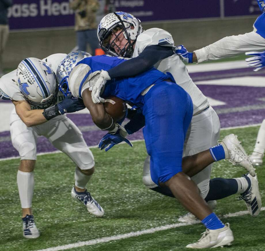 Greenwood's Brody Ray and Riley Butts combine to stop Lubbock Estacado's Jermiah Dobbins 11/29/19 at Anthony Field on the campus of Abilene Christian University. Tim Fischer/Reporter-Telegram Photo: Tim Fischer/Midland Reporter-Telegram