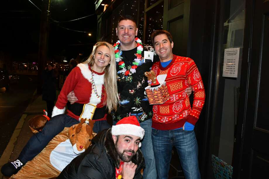 The annual ugly sweater bar crawl took place in downtown Milford on November 29, 2019. Participants donned their ugliest sweaters and enjoyed drink specials and a raffle. Proceeds benefited CT Friends of Phoenix, a burn survivor peer support program. Were you SEEN? Photo: Vic Eng / Hearst Connecticut Media Group