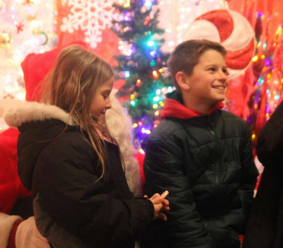 The Pigeon Town Lighting Celebration drew quite a crowd as people gathered to take pictures with Santa Claus, try homemade chili, take carriage rides and observe the lighting of trees on Friday, Nov. 29. Photo: Eric Rutter/Huron Daily Tribune