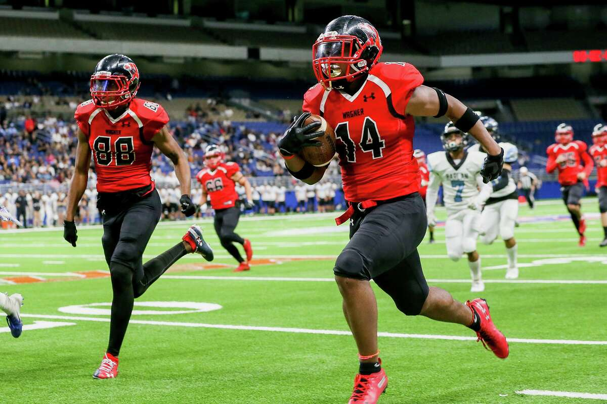 Wagner's Joerell Brown, 14, races down the sideline on a 58-yard touchdown run during the first half of their third round Class 5A Division I high school football playoff game with Harlan at the Alamodome on Friday, Nov. 29, 2019.