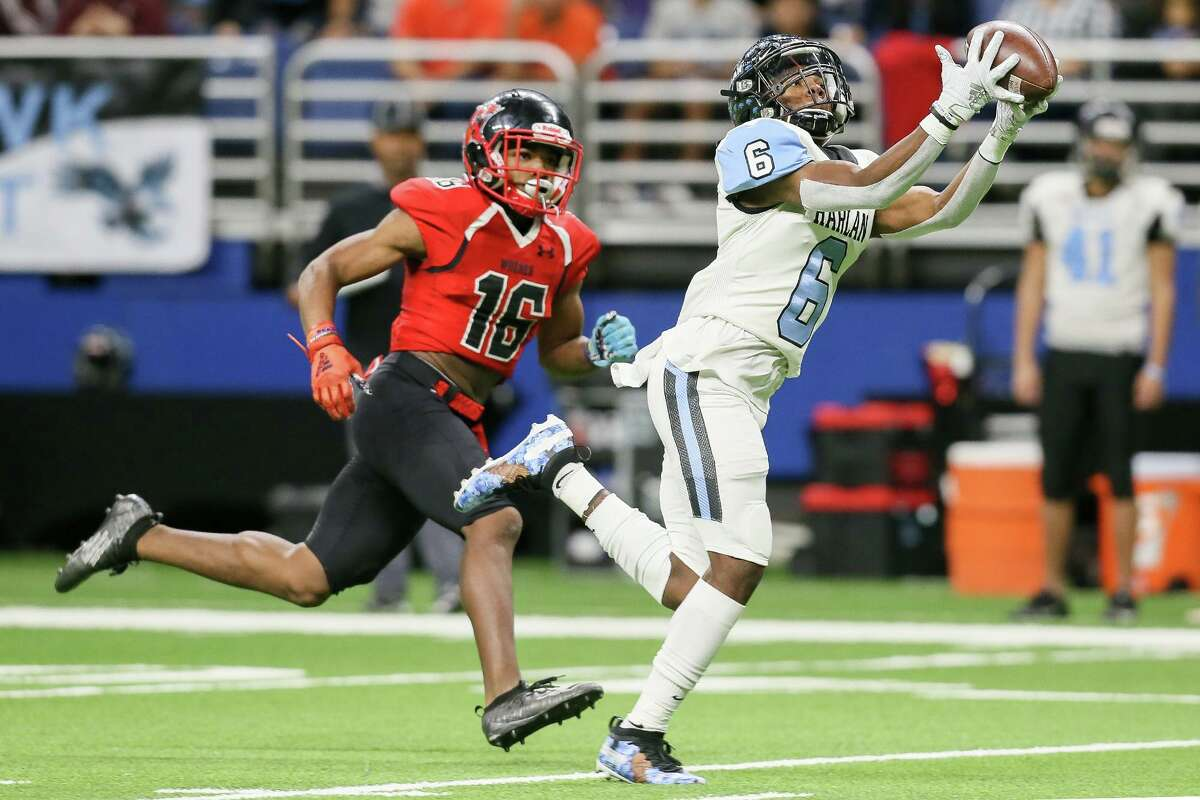 Harlan wide receiver Jacory Logan hauls in a pass over Wagner's Avante Stevens during the first half of their third round Class 5A Division I high school football playoff game at the Alamodome on Friday, Nov. 29, 2019.