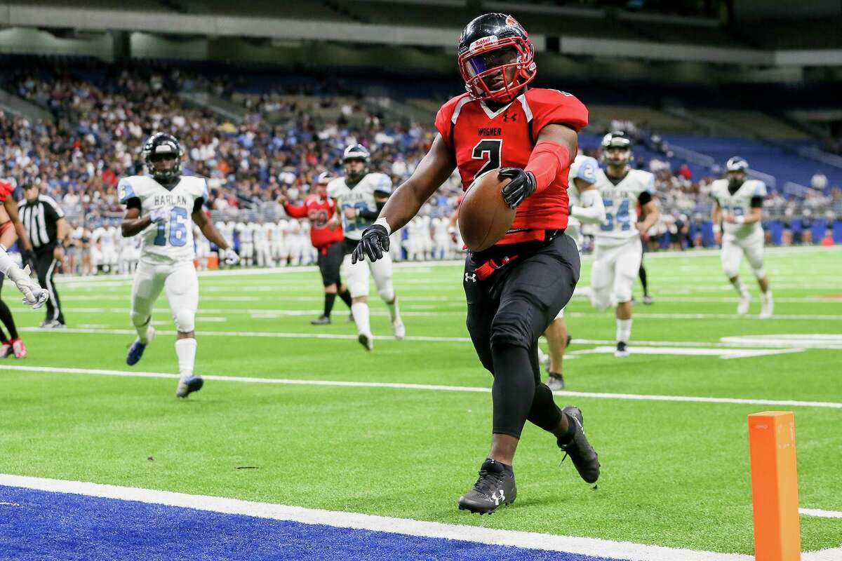 Wagner running back L.J. Butler crosses the goal line on a 20-yard touchdown run during the first half of their third round Class 5A Division I high school football playoff game with Harlan at the Alamodome on Friday, Nov. 29, 2019.