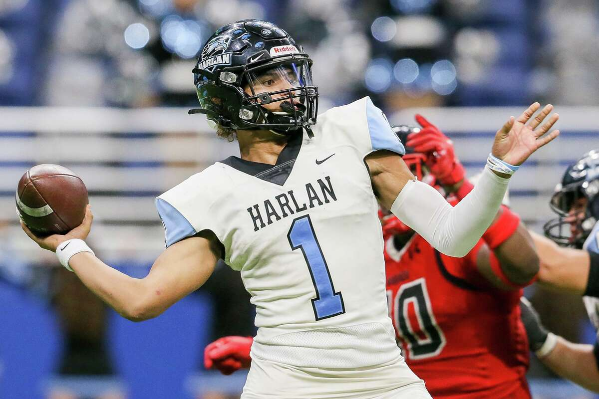 Harlan quarterback Kannon Williams drops back to pass during the second half of their third round Class 5A Division I high school football playoff game with Wagner at the Alamodome on Friday, Nov. 29, 2019. Wagner held on to beat Harlan 48-46.