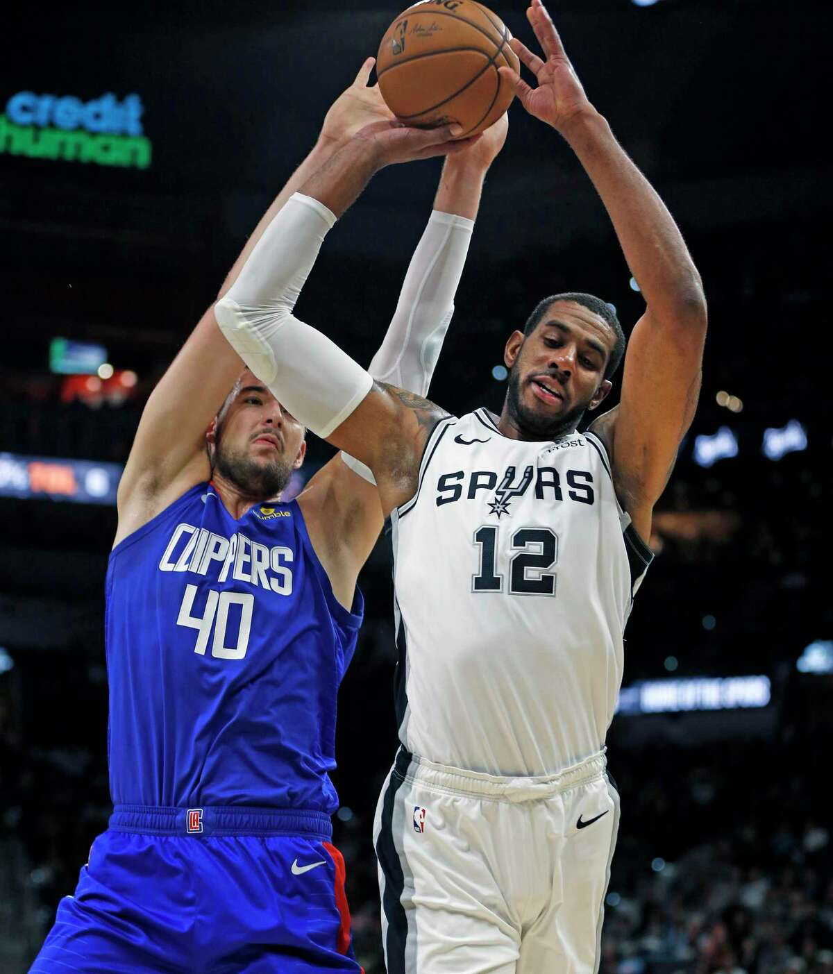 LaMarcus Aldridge #12 of the San Antonio Spurs is fouled by Ivica Zubac #40 of the Los Angeles Clippers in the first half of the game between the San Antonio Spurs and the Los Angeles Clippers on Friday, November 29,2019 at AT&T Center