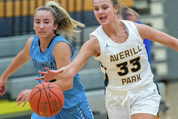 Averill Park sophomore Amelia Wood and Columbia sophomore Stella Forte reach for the ball during the Averill Park Tip Off Tournament at Averill Park High School on Friday, Nov. 29, 2019 (Jim Franco/Special to the Times Union.)