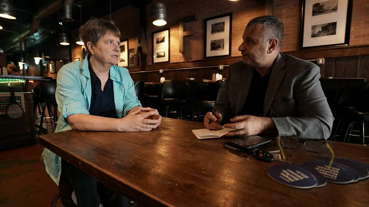 Frank Parlato, right, talks with former NXIVM insider Susan Dones, who left the organization in 2009. Parlato is the host of