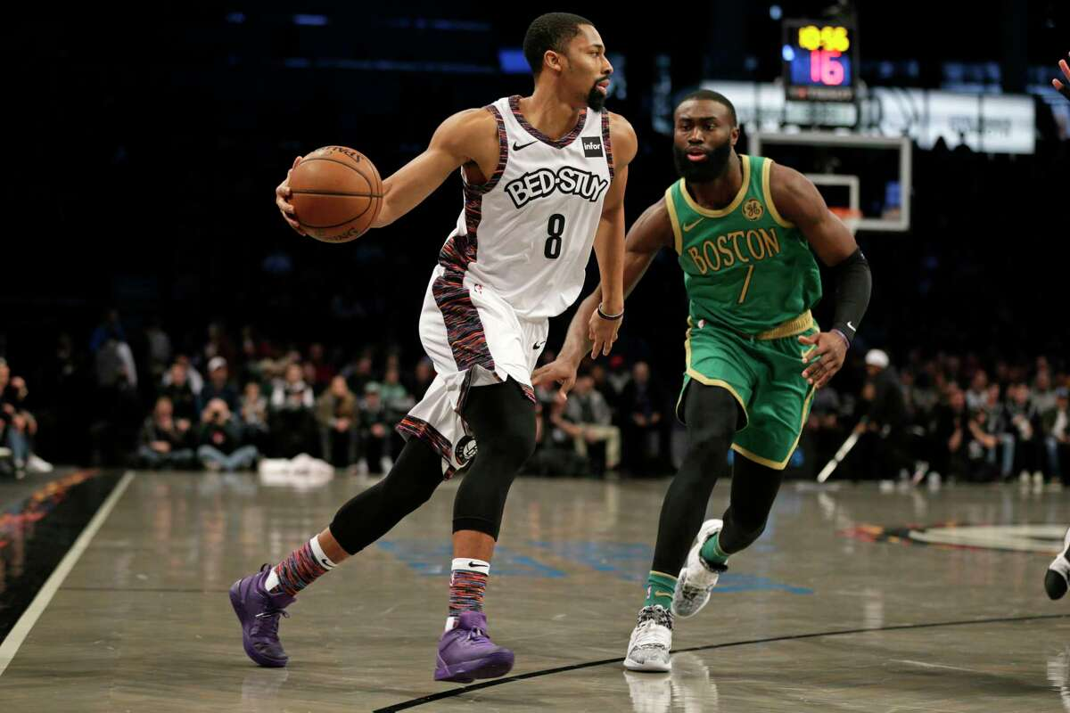 Brooklyn Nets guard Spencer Dinwiddie (8) looks to pass around Boston Celtics guard Jaylen Brown (7) during the first half of an NBA basketball game Friday, Nov. 29, 2019, in New York. The Nets won 112-107. (AP Photo/Adam Hunger)