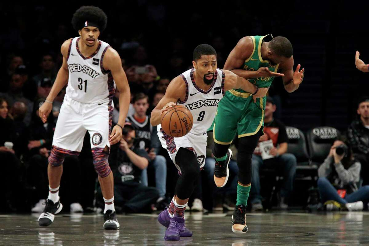 Brooklyn Nets guard Spencer Dinwiddie (8) steals the ball from Boston Celtics guard Kemba Walker during the first half of an NBA basketball game Friday, Nov. 29, 2019, in New York. The Nets won 112-107. (AP Photo/Adam Hunger)