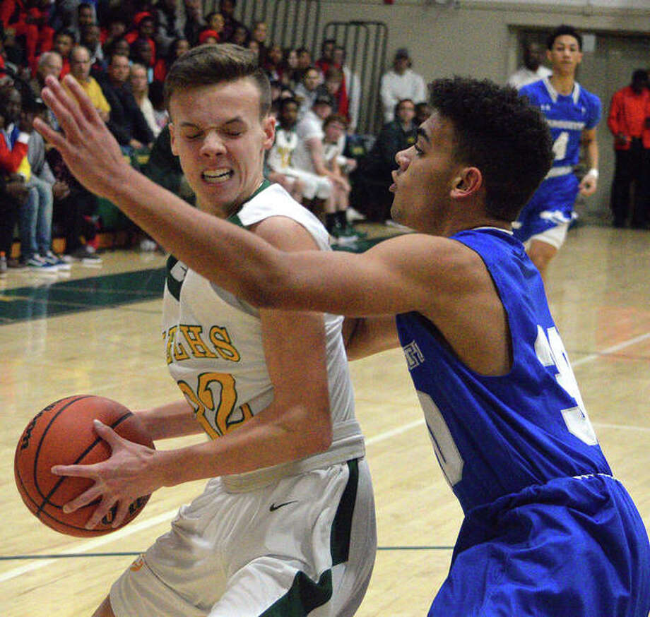 Metro-East Lutheran's Elliott Wilson, left, tries to get past a Marquette defender during Friday's semifinal game at the MELHS Turkey Tip-Off. Photo: Scott Marion/The Intelligencer
