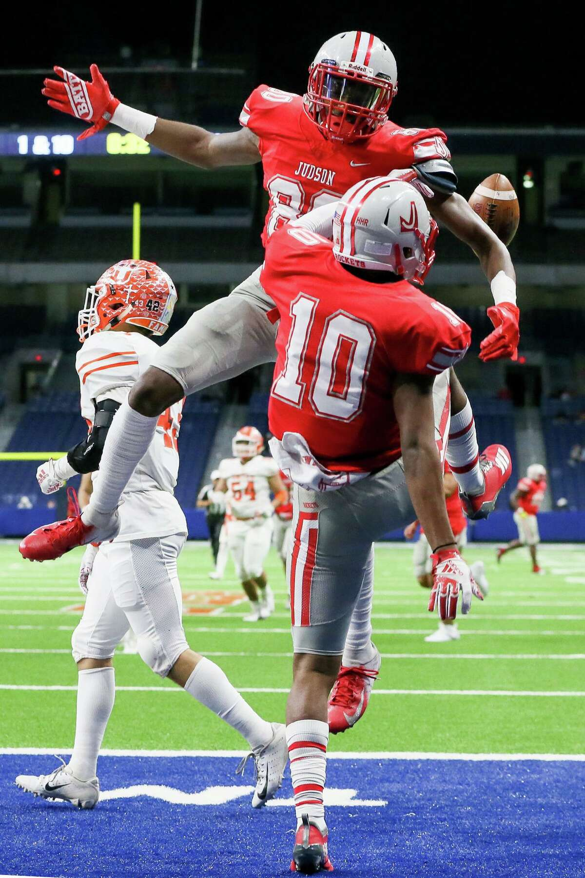 Judson's Anthony Shelton, front, celebrates his 71-yard touchdown reception with Davion Wilson during the first half of their third round Class 6A Division I high school football playoff game with Laredo United at the Alamodome on Friday, Nov. 29, 2019.