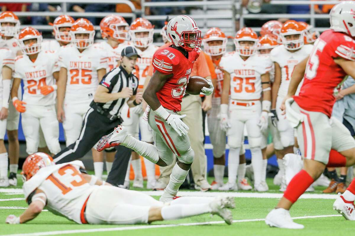 Judson's De'Anthony Lewis takes of on a 47-yard touchdown run on a fake punt in front of the Laredo United bench during the first half of their third round Class 6A Division I high school football playoff game at the Alamodome on Friday, Nov. 29, 2019.