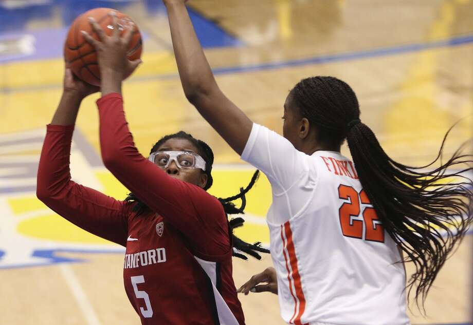 Stanford's Francesca Belibi is defended by Syracuse's Amaya Finklea-Guity during the first half Friday in Victoria, British Columbia. Photo: CHAD HIPOLITO / Associated Press