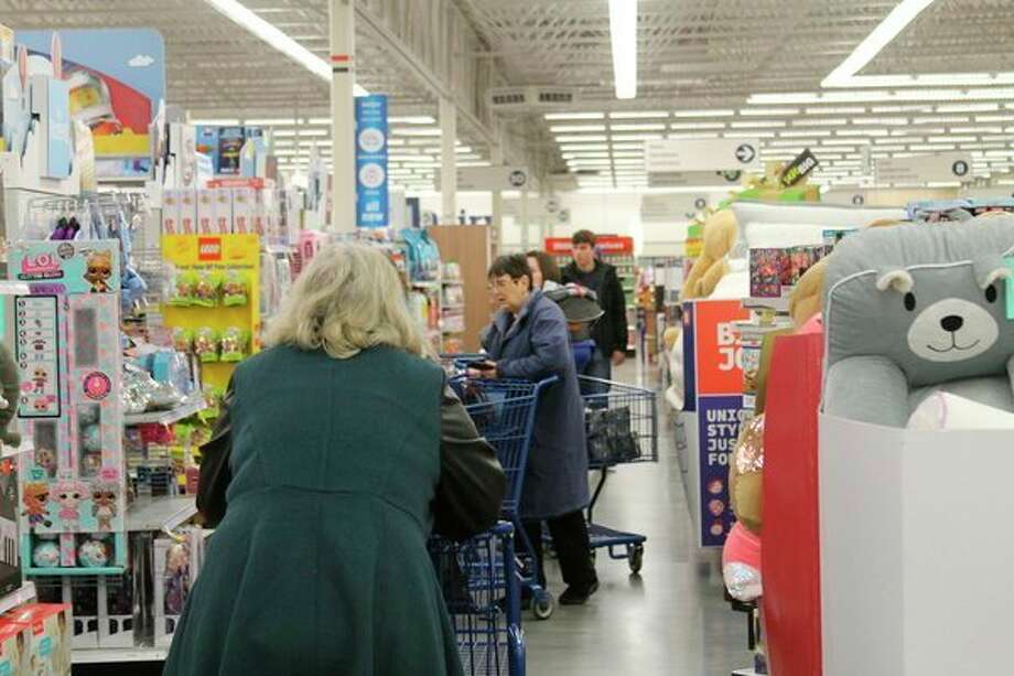 Manistee Meijer shoppers peruse the toy sections in search of deals, during Black Friday. (Scott Fraley/News Advocate)