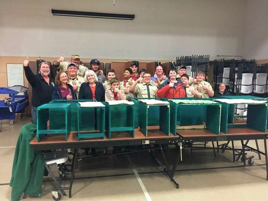 Volunteers from Rolling Thunder Chapter 1 and Scout Troop No.1193 pose with cat boxes they created for Homeward Bound Animal Shelter. (Courtesy photo)