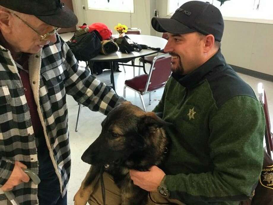 Manistee County Sheriff Department's Deputy Brandon Gillispie introduces his new partner, Faro, to area seniors during Monday's Police Talk at the senior center. (Courtesy photo)