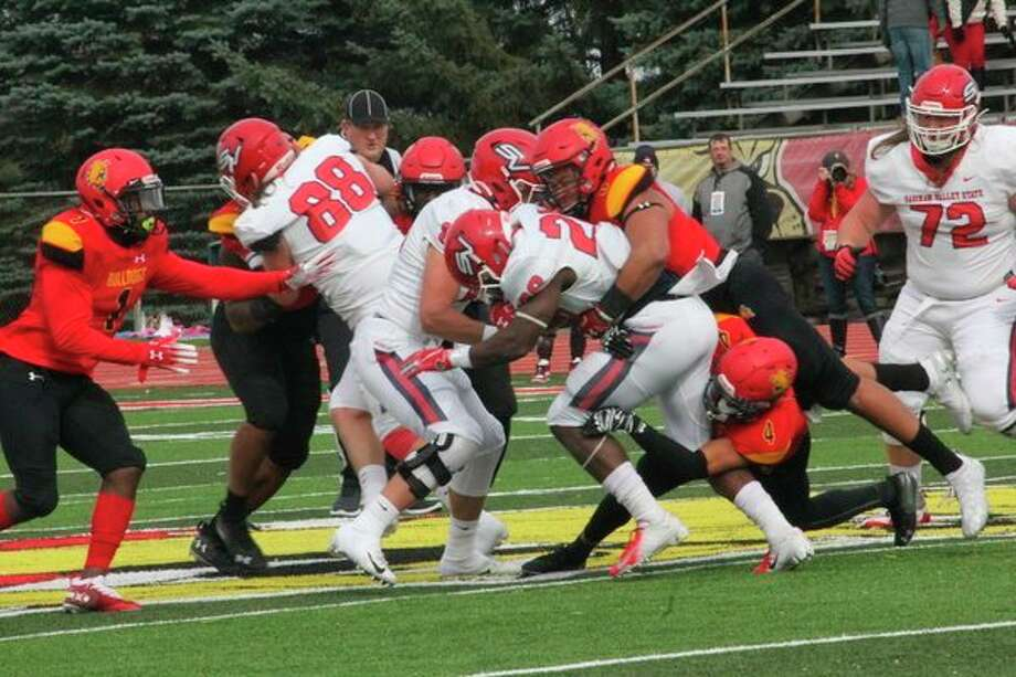 GLIAC player of the year Austin Edwards (8) makes the tackle for Ferris during the regular season