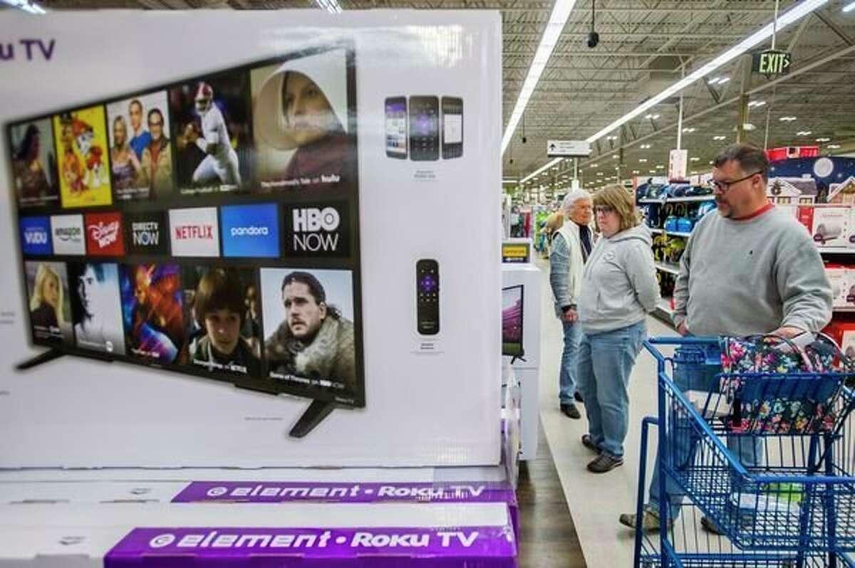 Shoppers take advantage of Black Friday deals at Meijer, which began on Thanksgiving morning, Thursday, Nov. 28, 2019. (Katy Kildee/kkildee@mdn.net)