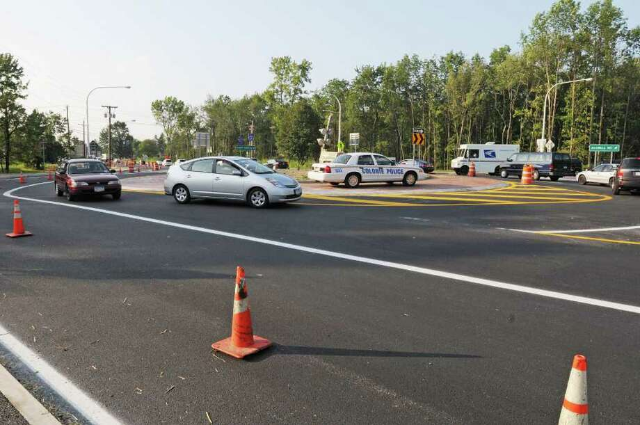 Cars use the new roundabout on it's opening day on Albany Shaker Rd. in Colonie, NY on August 10, 2010.   (Lori Van Buren / Times Union) Photo: Lori Van Buren