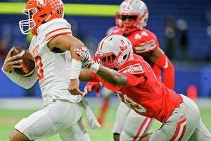 Judson's E'Vaunte Freeman, right, chases down Laredo United quarterback Wayo Huerta from behind during the first half of their third round Class 6A Division I high school football playoff game at the Alamodome on Friday, Nov. 29, 2019.