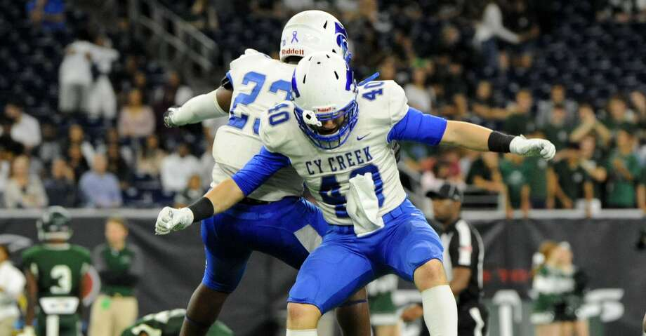 Travis Alonge (40) and Korey Celestine (23) of Cy Creek celebrate their victory over the Strake Jesuit Crusaders in a Class 6A Division II Region III semifinal football playoff game on Friday, November 29, 2019 at NRG Stadium, Houston, TX. Photo: Craig Moseley/Staff Photographer