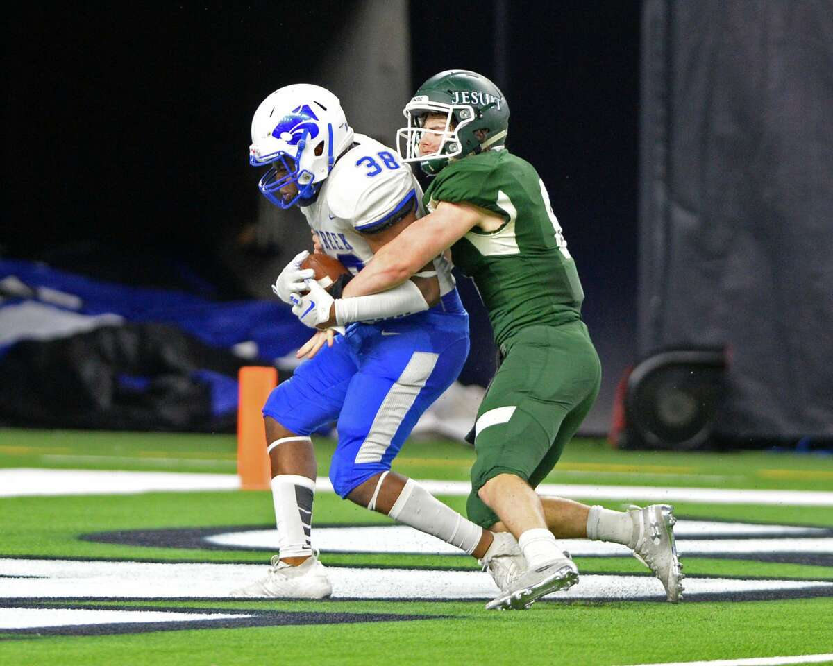 Byron Blassingame (38) of Cy Creek scores a touchdown on an interception by tipping a pass to himself in the end zone during the fourth quarter of a Class 6A Division II Region III semifinal football playoff game between the Strake Jesuit Crusaders and the Cy Creek Cougars on Friday, November 29, 2019 at NRG Stadium, Houston, TX.