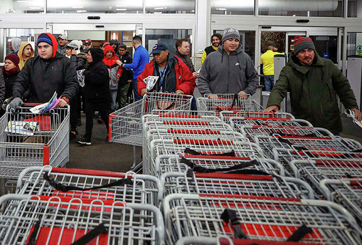 Shoppers enter a Best Buy store for Black Friday deals. The day after Thanksgiving marks the beginning of the holiday shopping season, with many retailers opening their doors earlier and most offering deeply discounted items to get people in the doors.